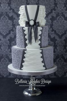 - This was the cake for my own birthdayparty yesterday. I wanted to make a corset cake for a long time, but I didn't want to carve the cake (hahaha). I love the colour grey and white. I have used cornelli lace with royal icing and I think that this is perfect look for the corset.  Bellaria Cakes Design www.facebook.com/bellariacakesdesign