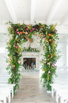 Whimsical Greenery Wedding Arch with Colorful Flowers Wedding Arch Greenery, Wedding Arbors, Wedding Arch Rustic, Garden Wedding, Summer Wedding, Wine Box Ceremony, Colorful Centerpieces, Wedding Highlights, Bright Flowers