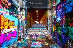 """.... Authorized graffiti area in London... Leake Street, also known as the """"Banksy Tunnel"""" or """"Graffiti Tunnel"""", is a road in Lambeth."""