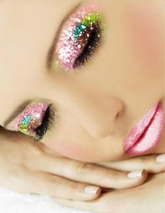 Glittery multi-coloured makeup.