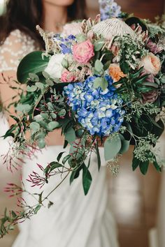 bouquet with hydrangeas - photo by Logan Clement Photography http://ruffledblog.com/romantic-iowa-wedding