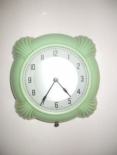 Green Bakelite electric wall clock i adore this color
