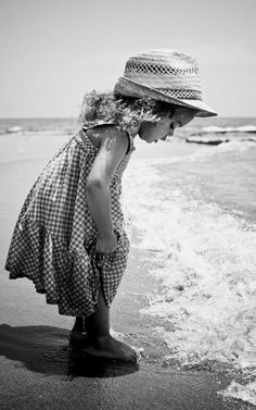 Girl, kid, child, at the beach, curiosity, curious, straw hat, cutie, cute, gesture, waves, water, b/w