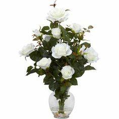 """Faux rose bush arrangement.  Product: Faux floral arrangment Construction Material: Silk and glass Features: Includes faux roses Color: WhiteDimensions: 22"""" H x 14"""" Diameter"""