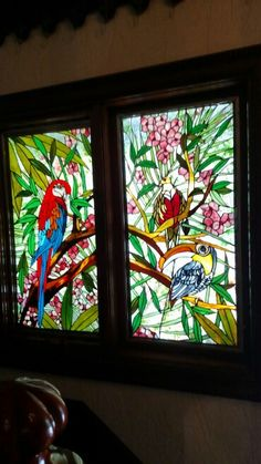 Stained glass done window done by me in 1984. Background is done using Bullseye confetti glass.
