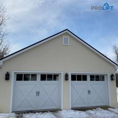 Shown here: Clopay Coachman, carriage house, insulated garage doors for a modern farmhouse detached garage. They're 'the perfect blend of beauty and practicality' since the doors have the appearance of painted wood doors but are actually constructed with a combination of steel and composite to maximize energy efficiency in a low maintenance product. | ProLift Garage Doors on Houzz | Project and Photo Credits: ProLift Garage Doors Haymarket Va