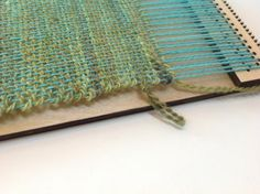 This patent pending portable weaving loom allows the user to make 3 different swatches with 8 ends per inch (e.p.i.), 10 e.p.i and 12 e.p.i. all from one single
