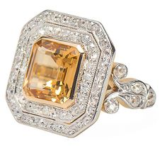An emerald cut natural topaz of an estimated 4.15 carats features cut off corners and a stepped design. A repeated use of this octagonal geometric form – a  pair of concentric eight-sided figures – studded with fifty-eight (58) old single cut diamonds ...