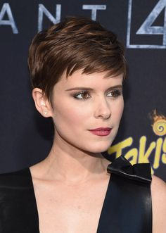 "Kate Mara channels a modern-day ""Rosemary's Baby"" with her piecey pixie and sophisticated makeup. <em>Her stylist used a <a href=""http://www.net-a-porter.com/us/en/product/397819?cm_mmc=ProductSearchUS_PLA_c-_-GHD-_-Beauty-Haircare-Dryers and Irons-_-120543757762_397819-005"