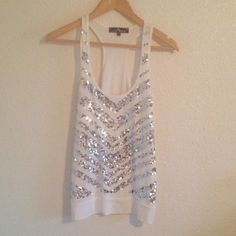 White Sequined Tank Almost Famous White Tank with a chevron pattern of silver sequins down the front. Worn plenty of times but always properly cared for. Size Medium. No sequins missing. Almost Famous Tops Tank Tops