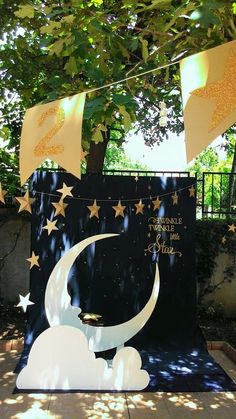 Moon PhotoBooth ; Cute photo idea...navy blue sheet background with stars, a bench to sit on, a big white moon made of styrofoam ; moon and star photo prop ; Gold + Glitter + Star themed birthday party ; twinkle twinkle little start party theme;twinkle little star