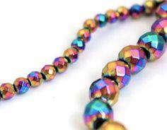 "Rainbow Hematite faceted round Beads 15"" Strand"