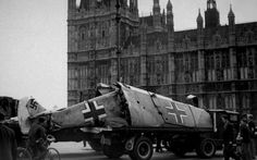A Messerschmitt aeroplane is paraded outside the Houses of Parliament, London, after being shot down by Spitfire pilots