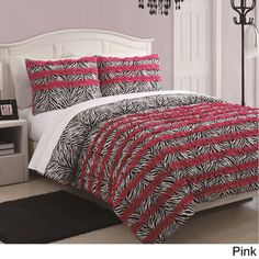 @Overstock.com - McKenzie 3-piece Ruffle Comforter Set - This reversible animal print and ruffle comforter is a great way to make a child's room stylish and hip. The fashion forward animal prints and added details such as the ruffles make a room everyone wants to hang out in.    http://www.overstock.com/Bedding-Bath/McKenzie-3-piece-Ruffle-Comforter-Set/8434158/product.html?CID=214117  $39.99