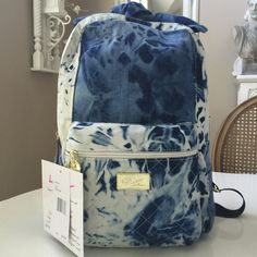 "Betsey LB Jayden BackpackHP This backpack is so cute! Top handle ties & the denim like print is adorable! Inside has 2 open pockets on one side & zip pocket on opposite. Back straps are 27"" at longest. Outside front pocket is 9.4"" X 10.5"" including depth. NWT Betsey Johnson Bags"