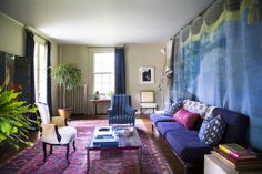 I love the idea of draping a tapestry on the wall in lieu of paint or wallpaper. It makes the space feel cozy and won't upset your landlord!