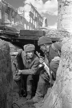 Soviet soldiers amidst the ruins