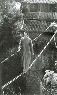 The Jiangyou Figure Hill Temple. Simple iron chain bridge, China, 1930s  vintage slacklining