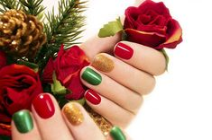 14 Christmas Nail Art Ideas | Simple nails can be just as stunning during the holiday season. Alternating red, green and a glittery metallic nail color looks bright and cheerful. This option is an easy way to let everyone know that you are truly in the Christmas spirit!