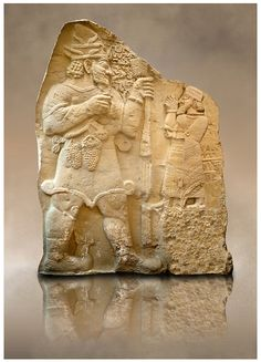 Moulding of 8th Cent. BC late Hittite rock relief . Warpalas, King of Tyana land, praying in front of a plant & storm god Tarhunza. From Ivriz (Konya, Ergeli) Turkey. |  © Paul Randall Williams 2012