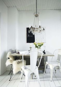 all white dining area #chandelier #fur #kitchen #seating