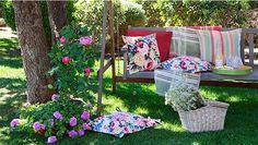 Hollywood swing with flowery cushions