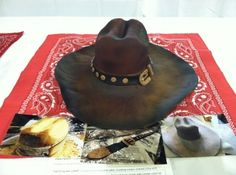 I cannot stop looking at this cake!!  I expect Lyle Lovett to walk over and put it on any minute.  She did an AMAZING job!    Leather Cowboy Hat By Pixelle on CakeCentral.com