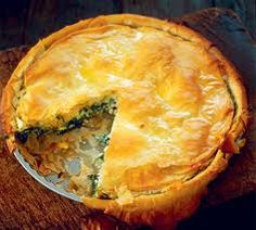 """Byrek ose Lakror (Albanian Leek, Spinach, or Scallion pie) """"Every New Year's Eve, the mother would make a lakror. She would place a coin somewhere inside the baked pie, and then the pan was whirled several times so as to lose track of the coin When the whircling stopped, the lakror was then cut into as many pieces as there were family members at the table. Whoever got the piece with the coin inside was supposed to have good luck throughout the New Year!"""""""