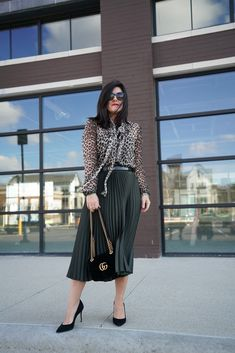 A pleated midi skirt is a gorgeous, versatile piece to add to your wardrobe this season. See how we styled this skirt for the office and beyond.  Plus, 5 affordable pleated skirts perfect for updating your Spring Style.    Spring Style Updates Under $50 | A Lily Love Affair  #springstyle #officestyle #pleatedskirt #leopard #womensfashion #streetstyle #itsbanana #gucci