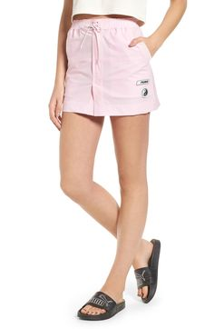 Free shipping and returns on FENTY PUMA by Rihanna Board Skirt at Nordstrom.com. The bungee-cord closure and nylon-blend construction of this pastel-pink mini flaunt the vintage-surf vibes that permeate Rihanna's latest collection for Puma.