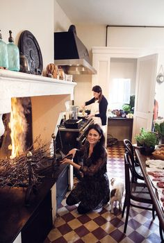Mimi in her finished kitchen. Vine shoots which have been pruned and dried for a year are used to create a fire, a traditional way to cook.