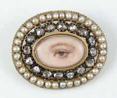 Mourning eye miniature  English  Circa 1820    Eye miniature brooch surrounded by diamonds set in black enamel and with a split pearl border.