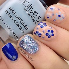 Blue sparkle and flower nails
