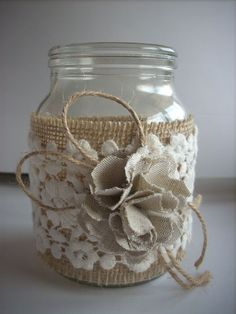 This listing is for a set of 4 hand-decorated jar. Decorated with burlap, lace and handmade flower fabric. They make a wonderful accent to your wedding whether its rustic, woodland, barn shabby, or vintage! This listing is for 4 jars . Rustic wedding decor, Lace and burlap mason jar, burlap centerpiece, country home decor.  dimensions: Height 5 or 12.5 cm