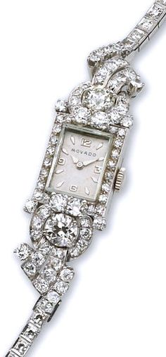 An art deco lady's diamond wristwatch, Movado, circa 1930 the rectangular dial with Arabic numerals at 3, 6, 9, and 12 within a bezel of single-cut diamonds, enhanced by old European-cut diamond scrolling shoulders and a single-cut bracelet; dial and movement signed Movado; estimated total diamond weight: 6.00 carats; mounted in platinum and fourteen karat white gold; length: 6in.