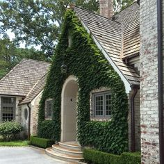 Boston Ivy covered facade in a motor court entry Traditional Architectural Detail Entryway Front Facade Garden Grounds by Howard Design Studio Exterior Design, Interior And Exterior, Facade Design, Design Studio, House Design, Boston Ivy, Fachada Colonial, Facade House, Ficus