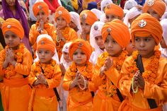 Indian Sikh school children dressed as Punj Pyara participate in a procession from the Sri Akal Takhat at the Sikh Shrine, The Golden Temple in Amritsar on October 8, 2014,