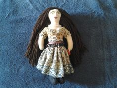 Same doll without her fur jacket.
