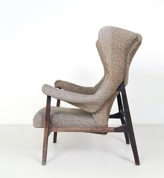 """Franco Albini A """"Fiorenza"""" armchair manufactured by ARFLEX, rare example that can be dated 1957. Solid rosewood and fabric upholstery.1500/1700 € Boetto 31 cot 2013"""