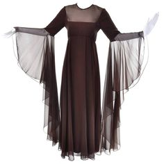For Sale on - This is an outstanding vintage evening gown from Estevez for the Eva Gabor Look. This brown chiffon maxi dress has dramatic statement sleeves that are Evening Gowns With Sleeves, Vintage Evening Gowns, Sequin Evening Dresses, Designer Evening Dresses, Vintage Dresses, Prom Dresses, Formal Dresses, Drop Waist Wedding Dress, Chiffon Maxi Dress