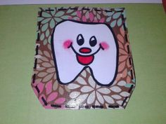 tooth pocket embellishment for scrapbooking. The pocket can hold a tooth.