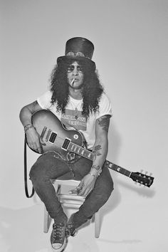 Slash. My brother loves him!!!!! so talented:)
