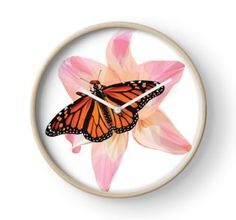 'Beautiful low poly Monarch Butterfly on a Pink Lily' Clock by ErinFCampbell Framed Prints, Art Prints, Pink Lily, Quartz Clock Mechanism, Monarch Butterfly, Modern Prints, Hand Coloring, Wall Tapestry, Decorative Throw Pillows