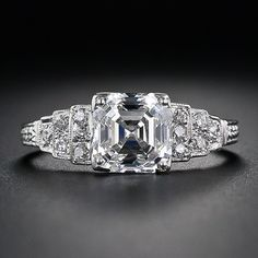 2.03 Carat Asscher Cut Diamond Engagement Ring. Platinum diamond-studded stairsteps set in classic geometric Art Deco style. This ring is AMAZING