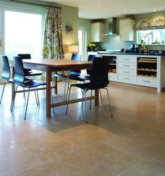 Cognac Limestone in a satino finish. These limestone kitchen floor tiles have attractive shell markings and fossils.