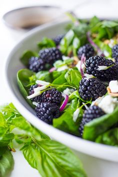 A refreshing Blackberry, Spinach and Basil Salad with crumbled goat cheese, and toasted almonds with a simple balsamic vinaigrette. #salad #health