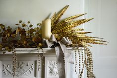 VV Rouleaux's exquisite Gold Silk Feather Spray combined with Champagne Sparkle Amaranthus and Ripe Wheat Boucle Lurex Ribbon. A sublime mantelpiece display