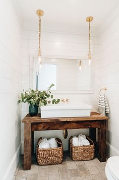 Powder room featuring a salvaged wood console table upcycled into a washstand fitted with a large ve&; Powder room featuring a salvaged wood console table upcycled into a washstand fitted with a large ve&; C B cbsugarandspice […] room storage combo Wood Vanity, House Bathroom, Interior, Wood Console Table, White Shiplap Wall, Home Decor, Bathroom Interior, Bathrooms Remodel, Bathroom Decor