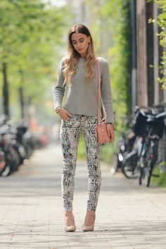 Patterned jeans, nude studded heels combined with a grey cashmere sweater. A pre-summer outfit with a little spring in the background.