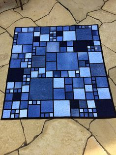 Denim quilt based on 2 inch square increments. 1 inch border strips.